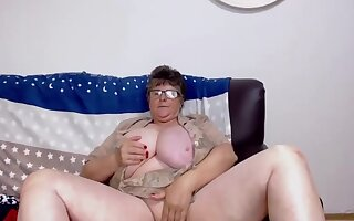 Sexy Grandma With Glasses Plays With Will not hear of Huge Tits