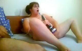 Cute chubby amateur slut with gaping cunt is fucking a large sex toy, while I'm near, jerking my dick.