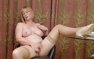 Chubby mature April spreads her legs to play with her wet cunt