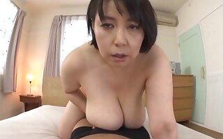 Fat Japanese mature Misuzu Tomizawa knows how to give a titjob